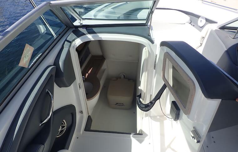 Door open on boat showing the marine toilet